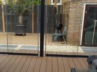 Composiet vlonderplank bankiraibruin houtnerf veranda